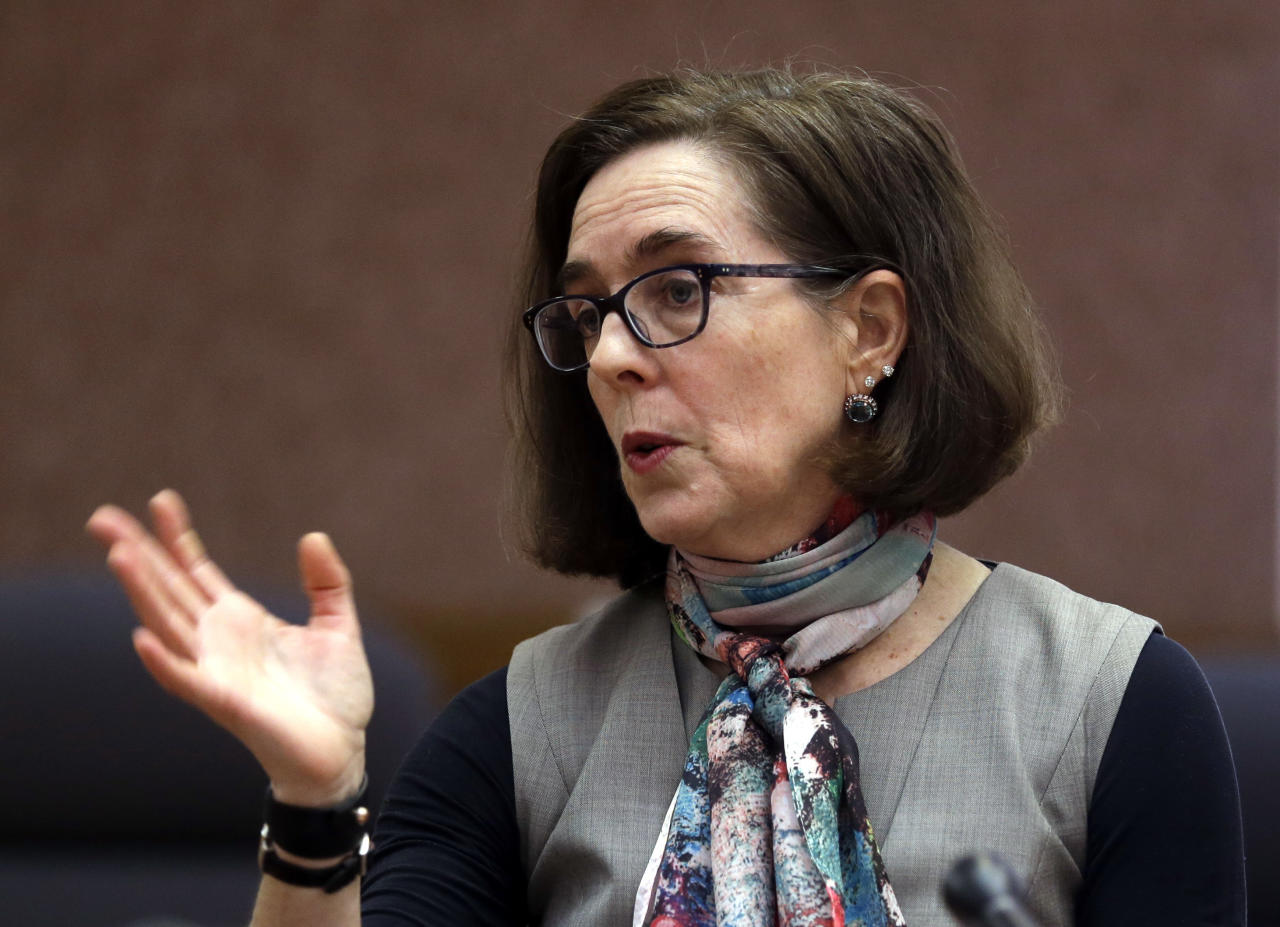 "FILE - In this Thursday, Jan. 26, 2017, file photo, Oregon Gov. Kate Brown speaks to media representatives in Salem, Ore. Governors in states that expanded Medicaid are wary of a bill revealed Thursday, June 22, by Republican leaders in the U.S. Senate. The expansion of the state-federal program has allowed 11 million lower-income Americans to gain health coverage. ""We anticipate it will be hundreds of thousands of Oregonians that will be stripped of health care under this proposal in order to get a tax break for wealthy Americans,"" said Brown, a Democrat. (AP Photo/Don Ryan, File)"