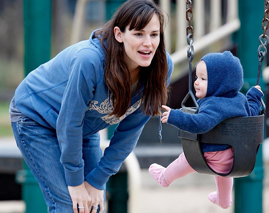 """The actress and her baby girl look like twins in their blue hoodies! <a href=""""http://www.splashnewsonline.com/"""" target=""""new"""">Splash News</a> - November 7, 2009"""