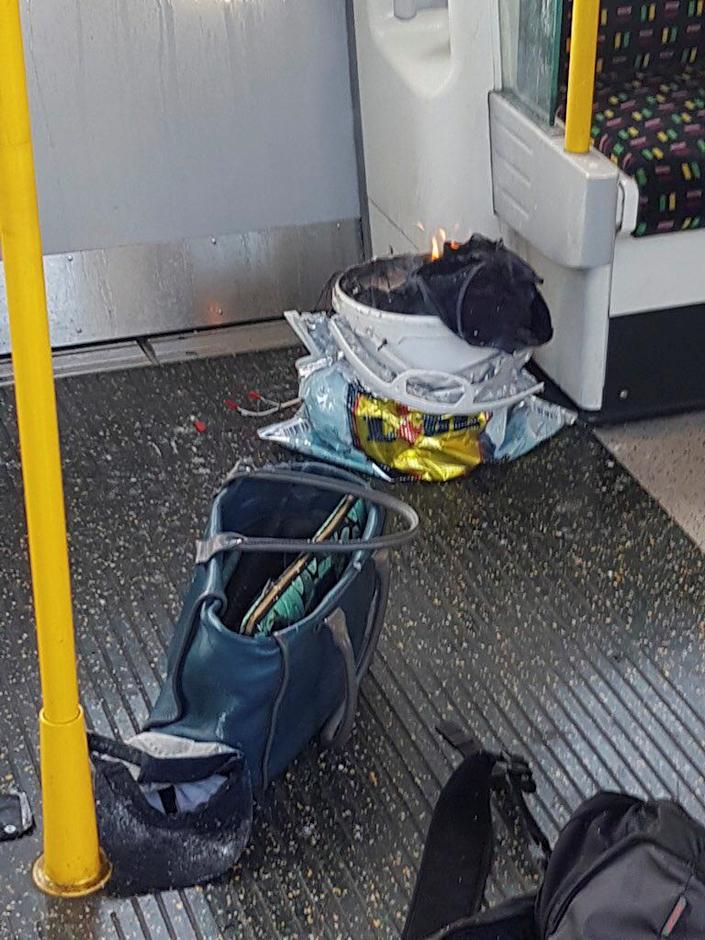 <p>Personal belonglongs and a bucket with an item on fire inside it, are seen on the floor of an underground train carriage at Parsons Green station in West London, Britain, Sept. 15, 2017, in this image taken from social media. (Photo: Sylvain Pennec via Reuters) </p>