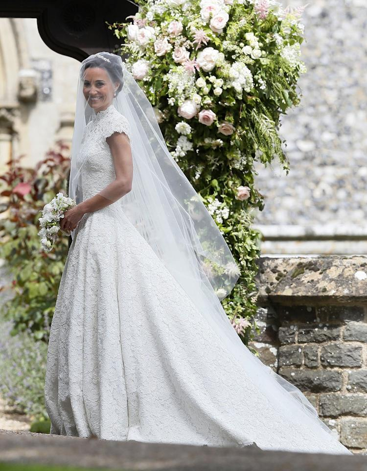 <p>The Duchess of Cambridge's younger sister Pippa wed her husband, James Matthews, in a custom dress by British fashion designer Giles Deacon. The brunette's gown featured capped sleeves, a high neck and a full skirt with train. <br /><em>[Photo: Instagram/Pippa Middleton]</em> </p>