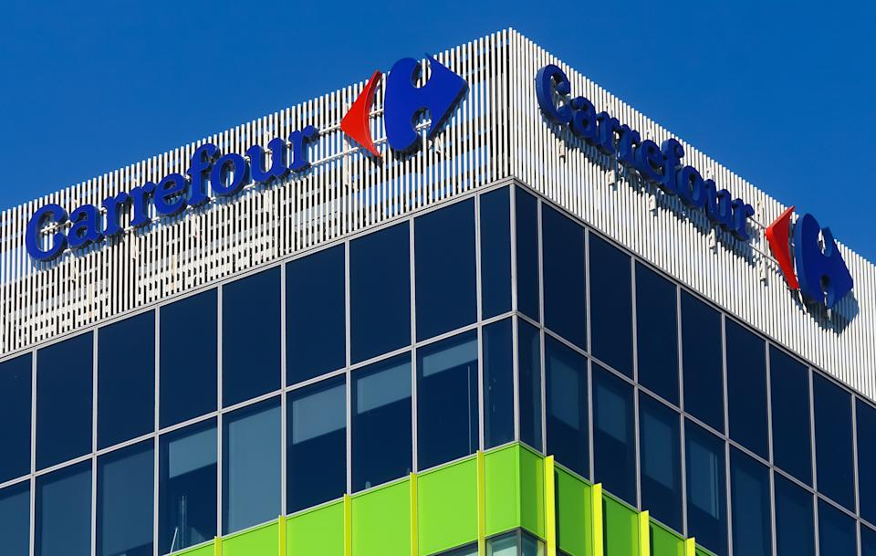 Bucharest, Romania - December 09, 2019: The logo of the French multinational retailer Carrefour is seen on top of Green Court Building B, in Bucharest. This image is for editorial use only.