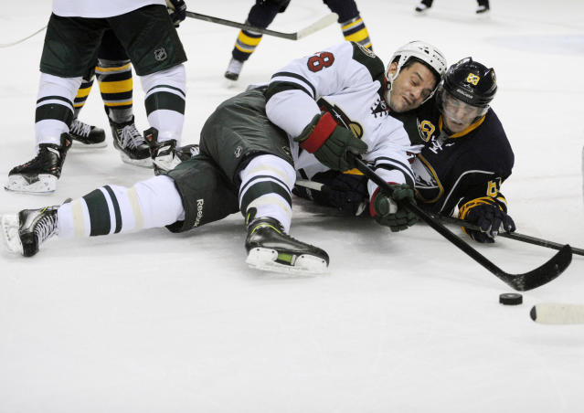 Minnesota Wild center Zenon Konopka (28) battles for the puck with Buffalo Sabres center Tyler Ennis (63) on a face off during the second period of an NHL hockey game in Buffalo, N.Y., Monday, Oct. 14, 2013. (AP Photo/Gary Wiepert)