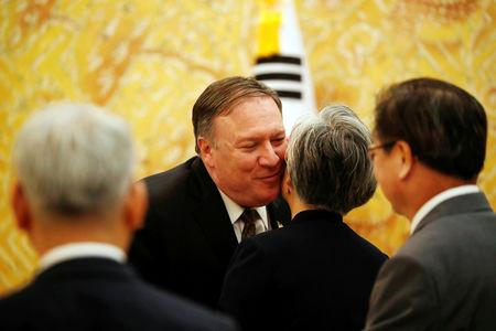 U.S. Secretary of State Mike Pompeo meets with South Korean Foreign Minister Kang Kyung-wha before meeting with South Korean President Moon Jae-in at the presidential Blue House in Seoul, South Korea, October 7, 2018.   REUTERS/Kim Hong-Ji/Pool
