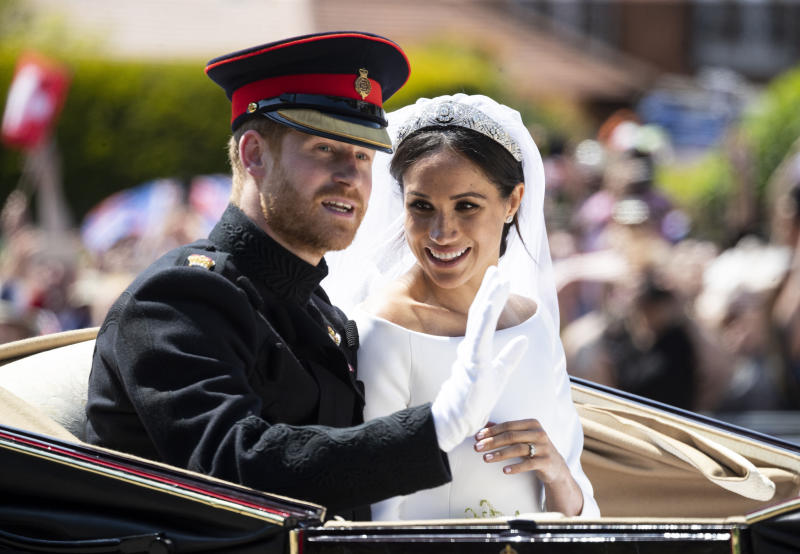 """January 20th 2020 - Buckingham Palace has announced that Prince Harry and Duchess Meghan will no longer use """"royal highness"""" titles and will not receive public money for their royal duties. Additionally, as part of the terms of surrendering their royal responsibilities, Harry and Meghan will repay the $3.1 million cost of taxpayers' money that was spent renovating Frogmore Cottage - their home near Windsor Castle. - January 9th 2020 - Prince Harry The Duke of Sussex and Duchess Meghan of Sussex intend to step back their duties and responsibilities as senior members of the British Royal Family. - File Photo by: zz/KGC-178/STAR MAX/IPx 2018 5/19/18 Prince Harry The Duke of Sussex and Meghan Markle The Duchess of Sussex - man and wife - at their wedding ceremony held at St. George's Chapel on the grounds of Windsor Castle. (Windsor, England, UK)"""