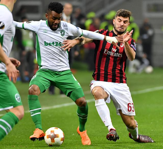 AC Milan's Patrick Cutrone, right, and Ludogorets' Cicinho compete for the ball during an Europa League round of 32 second leg soccer match between AC Milan and PFC Ludogorets Razgrad at the Giuseppe Meazza stadium in Milan, Italy, Thursday, Feb. 22, 2018. (Daniel Dal Zennaro/ANSA via AP)
