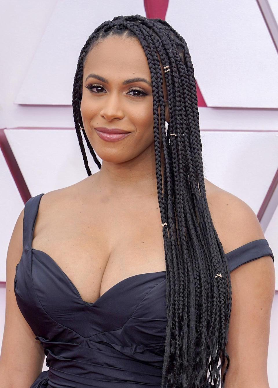 <p>Nicolette Robinson appeared on the red carpet alongside her husband Leslie Odom Jr. with her hair in long braids and soft, smoky makeup.</p>