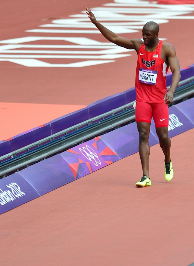 US' Lashawn Merritt waves to the crowd after pulling up from the men's 400m heats at the athletics event during the London 2012 Olympic Games on August 4, 2012 in London. AFP PHOTO / GABRIEL BOUYSGABRIEL BOUYS/AFP/GettyImages