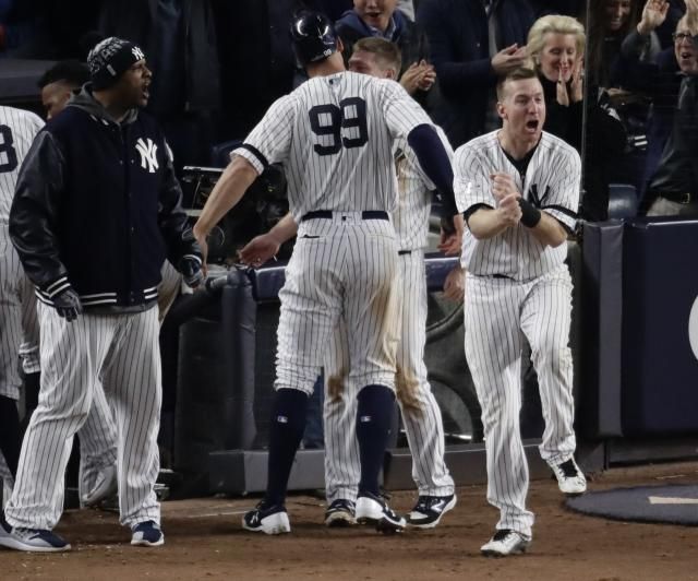 The Yankees' Todd Frazier celebrates after Aaron Judge scored during the eighth inning Tuesday. (AP)
