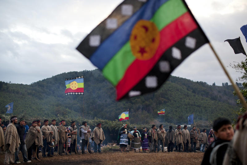 "In this Feb. 9, 2013 photo, Mapuche Indians from the Temucuicui Autonoma community wait to welcome members of other Mapuche communities to attend a ""Guillatun,"" a spiritual ceremony to ask for the well-being of the clan and strengthen ties in Ercilla, Chile. In the last three years, Chile's government has returned 10,000 hectares, or about 25,000 acres, to the Mapuche and encouraged timber companies and other landowners to allow the Mapuche to till small plots. Yet violence has only grown as the Mapuche demand the return of 750,000 hectares, or nearly 1.9 million acres, larger than the state of Delaware. (AP Photo/Rodrigo Abd)"
