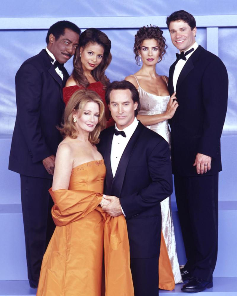Days Of Our Lives cast members pose at the Golden Globes in the 1990s.
