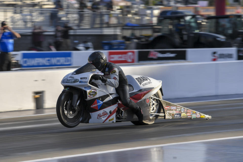 In this photo provided by the NHRA, Pro Stock Motorcycle points leader Steve Johnson races to the provisional No. 1 position in his first-round qualifying run on his Mac Rak/Slick 50 Suzuki at the DeWalt NHRA Carolina Nationals at zMAX Dragway in Concord, N.C., Friday, Sept. 17, 2021. (Richard H. Shute/NHRA via AP)