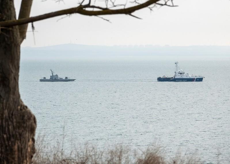 Seized Ukrainian naval ships are towed by Russia's Coast Guard vessels out of the port in Kerch