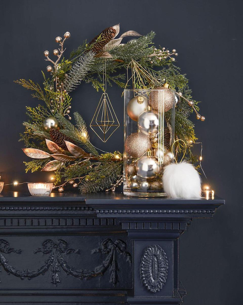 """<p>From elegant Christmas tree baubles (£5) to tasteful wreaths (£10), Tesco's Powdered Stone trend is perfect for adding some tranquility to your home. Featuring a fresh colour palette of white, gold and light pink, it brings an element of <a href=""""https://www.housebeautiful.com/uk/decorate/looks/g93/scandinavian-style-interior-inspiration/"""" rel=""""nofollow noopener"""" target=""""_blank"""" data-ylk=""""slk:hygge"""" class=""""link rapid-noclick-resp"""">hygge</a> to the home.</p>"""
