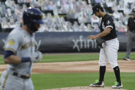 Chicago White Sox starting pitcher Gio Gonzalez, right, looks down as Milwaukee Brewers' Christian Yelich walks to firs4 during the first inning of a baseball game in Chicago, Thursday, Aug. 6, 2020. (AP Photo/Nam Y. Huh)