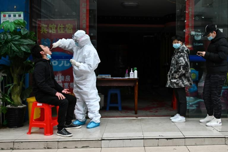 In schools and offices, China steps up virus tests