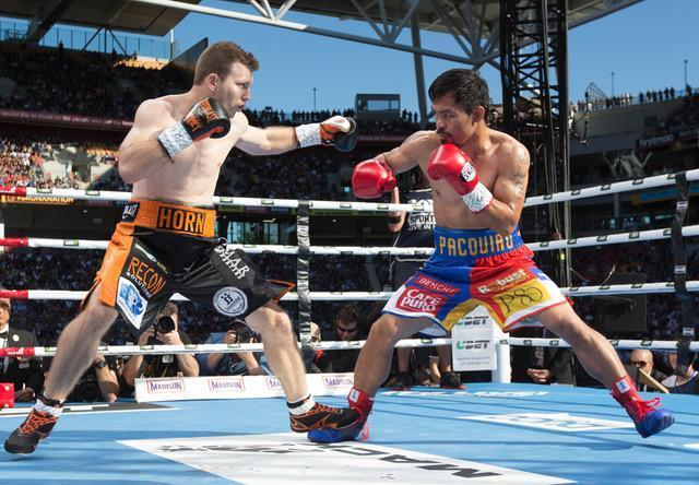 Jeff Horn (L) and Manny Pacquiao trade blows during their fight. (Duco Promotions)
