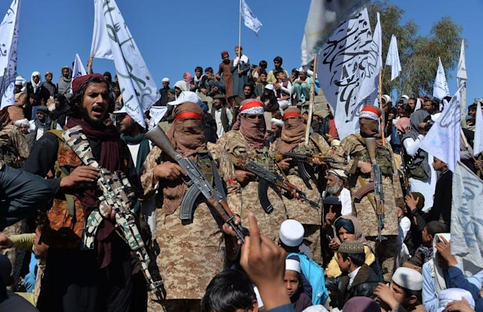 """<span class=""""caption"""">Taliban militants and Afghan civilians celebrate the signing of a peace deal with the United States on March 2.</span> <span class=""""attribution""""><a class=""""link rapid-noclick-resp"""" href=""""https://www.gettyimages.com/detail/news-photo/afghan-taliban-militants-and-villagers-attend-a-gathering-news-photo/1204647996?adppopup=true"""" rel=""""nofollow noopener"""" target=""""_blank"""" data-ylk=""""slk:Noorullah Shirzada/AFP via Getty Images)"""">Noorullah Shirzada/AFP via Getty Images)</a></span>"""