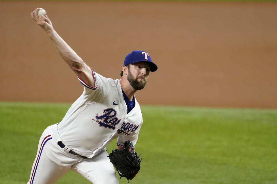 Texas Rangers starting pitcher Jordan Lyles throws to a Los Angeles Angels batter during the first inning of a baseball game in Arlington, Texas, Tuesday, Aug. 3, 2021. (AP Photo/Tony Gutierrez)