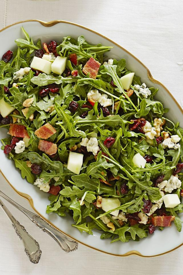"""<p>Bacon and blue cheese give this salad an exciting twist, while the orange dressing, arugula, and apples keep it lively and fresh.</p><p><em><a href=""""https://www.goodhousekeeping.com/food-recipes/a11597/cape-cod-chopped-salad-recipe-ghk1113/"""" target=""""_blank"""">Get the recipe for Cape Cod Chopped Salad »</a></em></p><p><strong>RELATED: </strong><a href=""""https://www.goodhousekeeping.com/holidays/thanksgiving-ideas/g1918/thanksgiving-dinner-recipes/"""" target=""""_blank"""">76 Best Thanksgiving Dinner Ideas of All Time</a><strong></strong></p>"""
