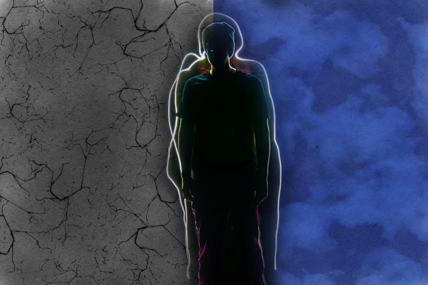 silhouette of a person against a divided backdrop