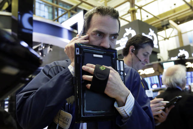 Traders Gregory Rowe, left, and Thomas Donato work on the floor of the New York Stock Exchange, Wednesday, Jan. 31, 2018. (AP Photo/Richard Drew)