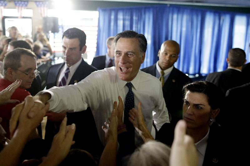 Republican presidential candidate, former Massachusetts Gov. Mitt Romney, greets supporters at his campaign headquarters in Jacksonville, Fla., Wednesday, Sept. 12, 2012. (AP Photo/Charles Dharapak)