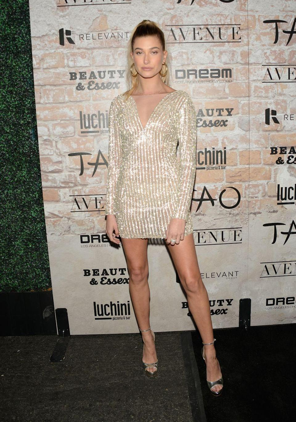 "<p>Hailey Baldwin attends day one of TAO, Beauty + Essex, Avenue + Luchini LA Grand Opening<span class=""redactor-invisible-space""> in California in a shimmery mini dress.</span></p>"
