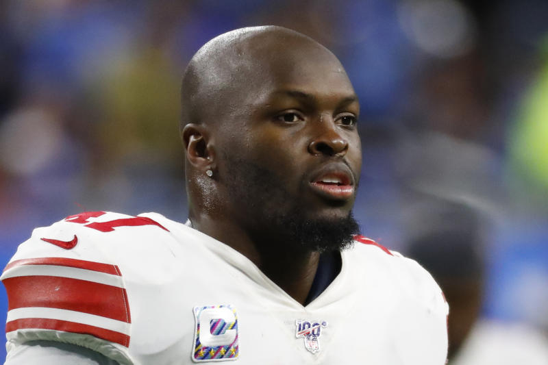 FILE - In this Oct. 27, 2019, file photo, New York Giants outside linebacker Alec Ogletree watches during an NFL football game against the Detroit Lions in Detroit. The New York Giants released linebackers Alec Ogletree and Kareem Martin, clearing significant salary cap space Wednesday, Feb. 26, 2020, with the departure of their two most expensive defensive players. (AP Photo/Paul Sancya, File)