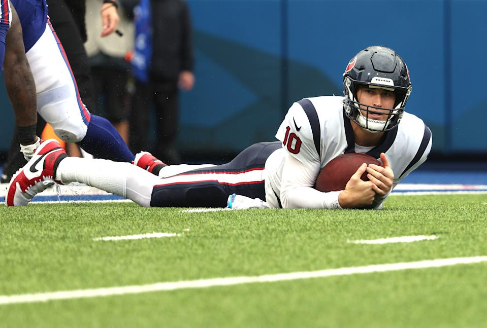 ORCHARD PARK, NEW YORK - OCTOBER 03: Quarterback Davis Mills #10 of the Houston Texans reacts after being sacked by the Buffalo Bills in second quarter at Highmark Stadium on October 03, 2021 in Orchard Park, New York. (Photo by Timothy T Ludwig/Getty Images)