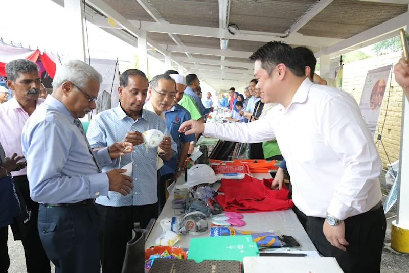 Human Resource Minister M. Kulasegaran visits the booths during the Occupational Safety and Health Week at the Malay-Sino Chemical Industries Sdn Bhd plant in Ipoh July 28, 2018. ― Picture by Marcus Pheong