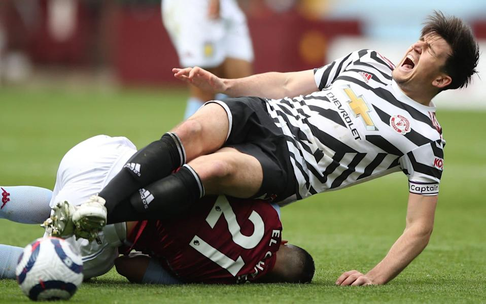 Harry Maguire was forced off injured after a heavy tackle - POOL/AFP via Getty Images