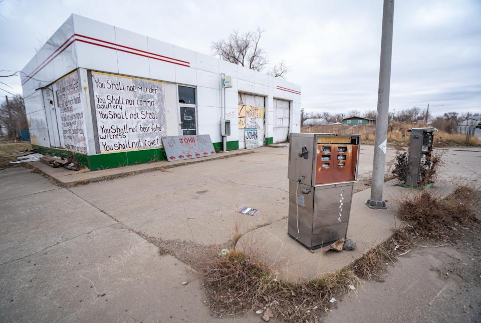 An abandoned gas station is one of the businesses that have shuttered in recent years along U.S. Highway 2, which bisects the rural community of Poplar in northeast Montana.