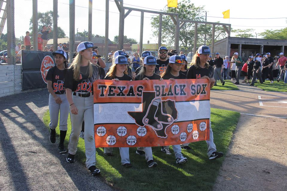 The Texas Blacksox parade into Beyer Stadium as part of the opening ceremony for Baseball For All's 2017 National Tournament. (Facebook/@baseballforall)