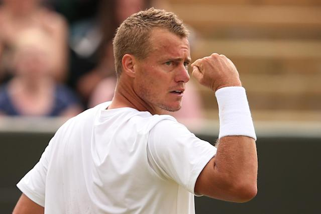 Australia's Lleyton Hewitt celebrates breaking the serve of Poland's Jerzy Janowicz during their men's singles second round match at Wimbledon on June 27, 2014 (AFP Photo/Andrew Yates)