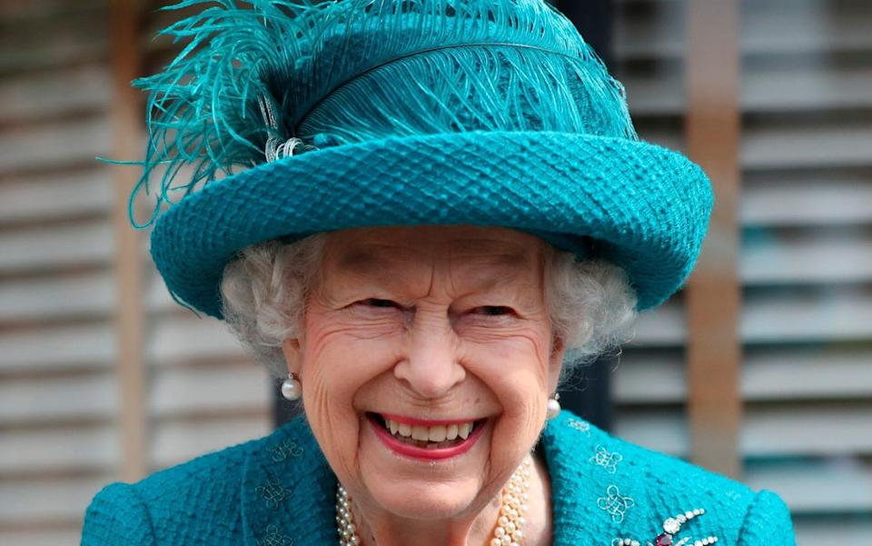 Queen Elizabeth visits the set of the long running television series Coronation Street, in Manchester - Scott Heppell/AP Photo