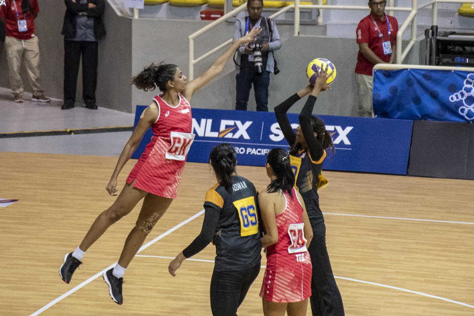 Singapore's Sindhu Nair tries to block a shot by Malaysia during their SEA Games gold-medal match at the Santa Rosa Sports Complex. (PHOTO: Alfie Lee/Sport Singapore)