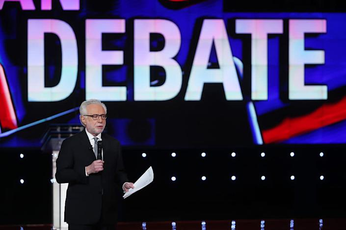 CNN anchor Wolf Blitzer speaks before the first round of the CNN Republican presidential debate on December 15, 2015 in Las Vegas, Nevada. | Justin Sullivan—Getty Images