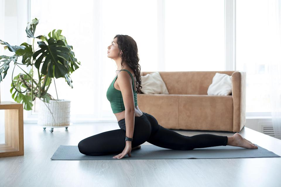 """<p class=""""body-text"""">We know that you know stretching regularly is important but are you actually doing it? From glute stretches to <a href=""""https://www.womenshealthmag.com/uk/fitness/workouts/a35848728/morning-stretches/"""" rel=""""nofollow noopener"""" target=""""_blank"""" data-ylk=""""slk:morning stretches"""" class=""""link rapid-noclick-resp"""">morning stretches</a>, warm-up and post-workout stretches, the world of releasing sore muscles is wide and far-reaching. Not to mention the myriad benefits of stretching regularly. </p><p>Because, if you're doing <a href=""""https://www.womenshealthmag.com/uk/lower-body-workouts/"""" rel=""""nofollow noopener"""" target=""""_blank"""" data-ylk=""""slk:lower body workouts"""" class=""""link rapid-noclick-resp"""">lower body workouts</a> and <a href=""""https://www.womenshealthmag.com/uk/fitness/workouts/a708457/exercise-for-a-bigger-butt/"""" rel=""""nofollow noopener"""" target=""""_blank"""" data-ylk=""""slk:exercises for a bigger butt"""" class=""""link rapid-noclick-resp"""">exercises for a bigger butt</a> at home, making sure you're stretching your glutes properly is essential. Or, if you're dedicated to <a href=""""https://www.womenshealthmag.com/uk/fitness/workouts/a707720/gym-workout/"""" rel=""""nofollow noopener"""" target=""""_blank"""" data-ylk=""""slk:gym workouts"""" class=""""link rapid-noclick-resp"""">gym workouts</a> and learning <a href=""""https://www.womenshealthmag.com/uk/fitness/strength-training/a708464/how-to-squat-properly/"""" rel=""""nofollow noopener"""" target=""""_blank"""" data-ylk=""""slk:how to squat properly"""" class=""""link rapid-noclick-resp"""">how to squat properly</a> or perfect your <a href=""""https://www.womenshealthmag.com/uk/fitness/strength-training/a708774/deadlift-variations/"""" rel=""""nofollow noopener"""" target=""""_blank"""" data-ylk=""""slk:deadlift variations"""" class=""""link rapid-noclick-resp"""">deadlift variations</a> technique, you need to stretch as well. </p><p>So, if you're not sure where to start , let us guide you through everything you need to know about glute stretches and our 15 favourite routines to relax and release so"""
