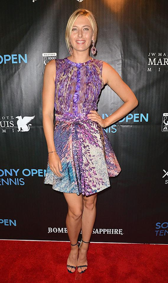 Tennis ace Maria Sharapova showed off her tanned gams in this silky J. Mendel masterpiece upon arriving at the Sony Open player's party at the Marriott Marquis in Miami. A loose updo, amethyst earrings, and midnight-blue sandals made for the perfect accessories. (3/19/2013)