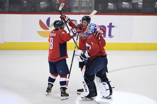 Washington Capitals goaltender Pheonix Copley (1) celebrates with right wing Tom Wilson, center, and left wing Alex Ovechkin (8), of Russia, after an NHL hockey game against the Buffalo Sabres, Saturday, Dec. 15, 2018, in Washington. (AP Photo/Nick Wass)