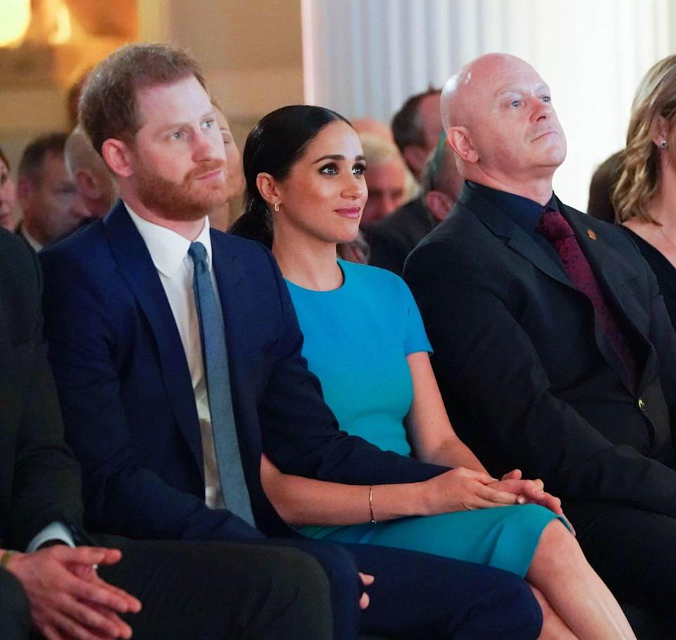 """<p>The Duke and Duchess of Sussex held hands as they listened to speeches and witness a <a href=""""https://www.elle.com/uk/life-and-culture/culture/a31256531/meghan-markle-prince-harry-surprise-proposal-london/"""" rel=""""nofollow noopener"""" target=""""_blank"""" data-ylk=""""slk:marriage proposal"""" class=""""link rapid-noclick-resp"""">marriage proposal</a> at the The Endeavour Fund Awards in London in March. </p><p>For the occasion, the mother-of-one wore a fitted teal dress by <a href=""""https://www.elle.com/uk/fashion/celebrity-style/longform/a36026/victoria-beckham-cover-interview-may-17-elle-uk/"""" rel=""""nofollow noopener"""" target=""""_blank"""" data-ylk=""""slk:Victoria Beckham"""" class=""""link rapid-noclick-resp"""">Victoria Beckham</a> and BB pumps by Manolo Blahnik. </p>"""