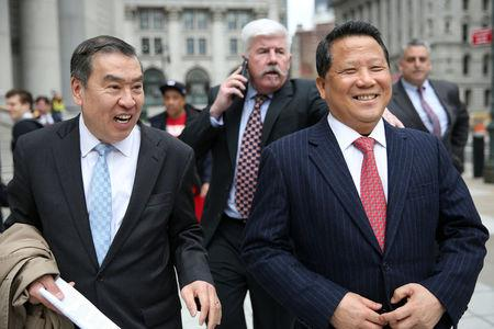 Macau billionaire real estate developer Ng Lap Seng (R), accused of bribing former United Nations General Assembly president John Ashe, exits the Manhattan U.S. District Courthouse in New York, U.S. April 7, 2017. REUTERS/Ashlee Espinal