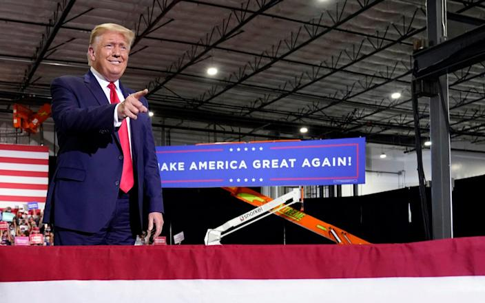 President Donald Trump arrives to speak at the rally - AP