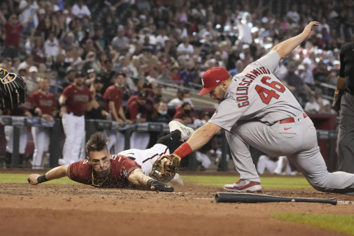 Diamondbacks' Tim Locastro gets tagged out by St. Louis Cardinals first baseman Paul Goldschmidt (46) trying to score a run on a ball hit by Josh Rojas in the sixth inning during a baseball game, Sunday, May 30, 2021, in Phoenix. (AP Photo/Rick Scuteri)