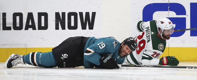 San Jose Sharks' Joe Thornton, left, and Minnesota Wild's Greg Pateryn fall to the ice during the first period of an NHL hockey game Tuesday, Nov. 6, 2018, in San Jose, Calif. (AP Photo/Ben Margot)