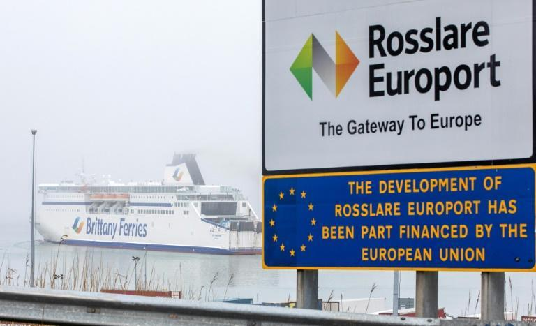 """On the sloping approach to the docks, a sign welcomes the steady stream of traffic to """"Rosslare Europort: the gateway to Europe"""""""