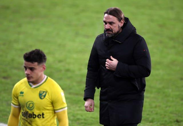 Norwich City manager Daniel Farke (right) walks off with Max Aarons (left)