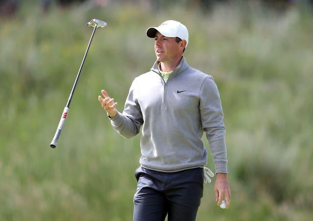 Rory McIlroy juggles his putter