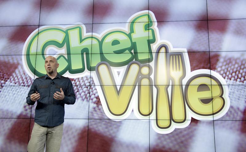 Zynga General Manager of ChefVille Jonathan Knight talks about ChefVille game during an announcement at Zynga headquarters in San Francisco, Tuesday, June 26, 2012. Zynga said Tuesday it is expected to add more Web games to its digital arcade and introduce more ways to play them as it tries to lessen its dependence on Facebook and generate more revenue. (AP Photo/Paul Sakuma)