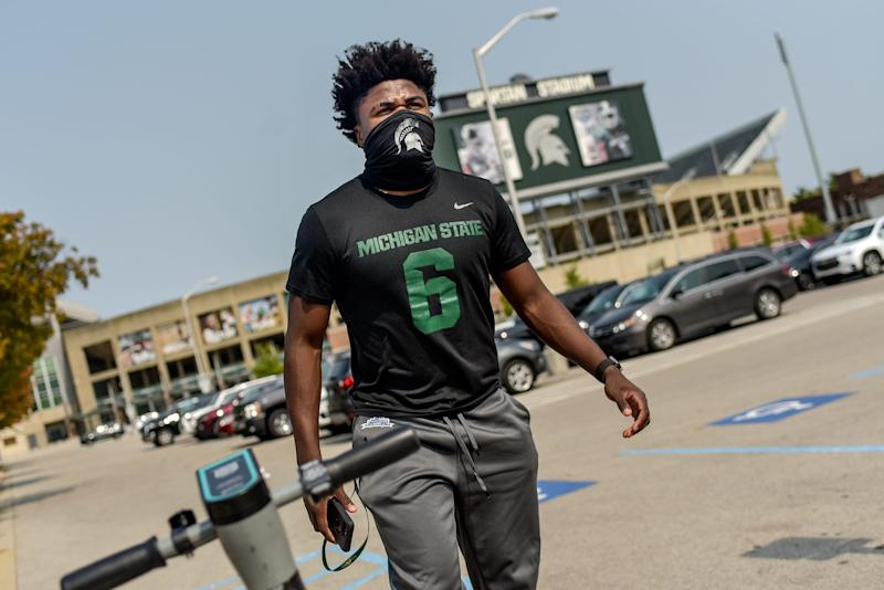 Michigan State football player Michael Dowell walks to the Skandalaris Football Center/Duffy Daugherty Football Building on Wednesday, Sept. 16, 2020, in East Lansing. On Dowell's shirt is the number his brother David wore during his time with the MSU football team.